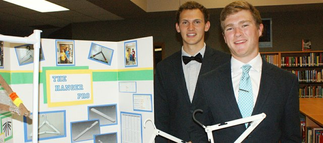 BLHS seniors Paul Rehm, right, and Jared Kenton display their Hanger Pro design that won them first place at Wichita State University's Project Lead the Way competition this spring.