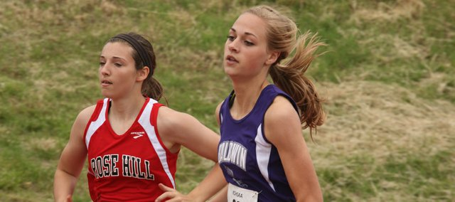 Baldwin junior Morgan Lober qualified first in the 400-meter dash Friday at the 4A state track meet in Wichita. Teammate Glenn Kelley McCabe was fourth and will also be in the finals as the Bulldog girls team seeks to bring the state title back to Baldwin City.