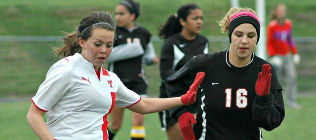 Junior Aly Bartholomew, left, was one of four THS spring athletes to earn a first-team All-KVL selection.