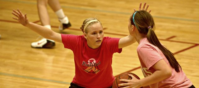 Kaitlin Hall plays defense on Monday at the Tonganoxie High girls basketball camp.
