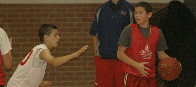 Matt Scharff, left, plays defense against Colten Pope in last week's freshman boys basketball camp at Tonganoxie High.