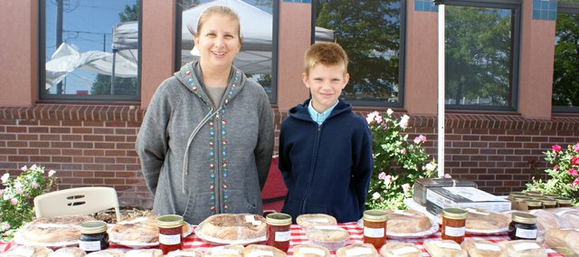 Shannon Cox started her own business called Summer Sun Bakery this year and sells her baked goods at the Basehor Historical Society Farmers' Market on Saturdays. Last week she was joined by her son, at right, Daniel Cox.