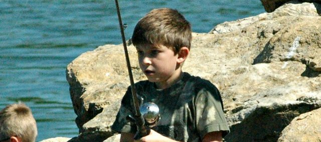 Cooper Edmonds waits for a bite during Friday's youth fishing clinic.