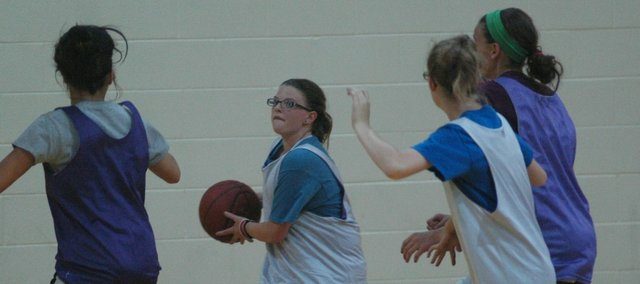 Sydney Murr weaves her way through a group of defenders on her way to the basket at last week's McLouth team camp.