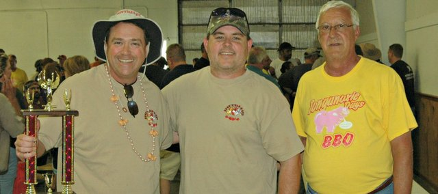 Brew 'N' Bar-B-Que was the grand champion of the 2013 Tonganoxie Days BBQ Blowout. The Shawnee-based team won the title and a $1,250 cash prize. Pictured, from left, are Chris Cox, Dan Mills and event coordinator Jim Hannah.
