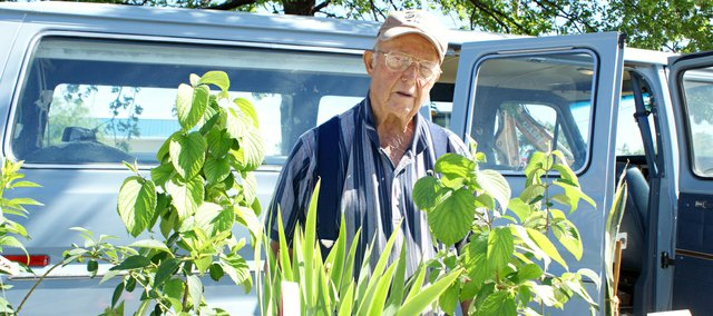 Joe Nick sells plants and produce at the Basehor Historical Society's Farmers' Markets on Saturday.