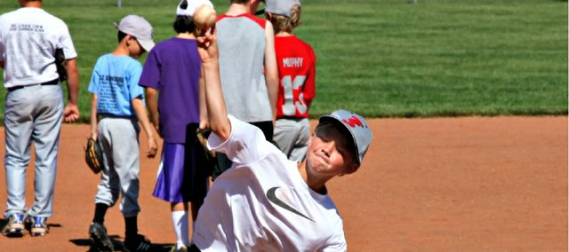 Jace Goebel throws a pitch during the Blue Devil Baseball Camp last week at the Leavenworth County Fairgrounds.