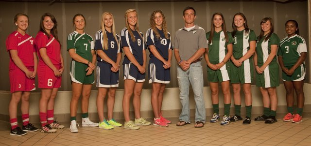 The 2013 Journal-World All-Area girls soccer team, from left, Emily Soetaert, Tonganoxie; Aly Bartholomew, Tonganoxie; Maddie Dieker, Free State; Kayla Hamner, Mill Valley; Abby Sieperda, Mill Valley; McKenzie Koch, Mill Valley; Coach of Year Jesse Smith, De Soto; Allison Stanley, De Soto; Michelle Keleher, De Soto; Lauryn Leininger, De Soto; and Olivia Hodison, Free State.