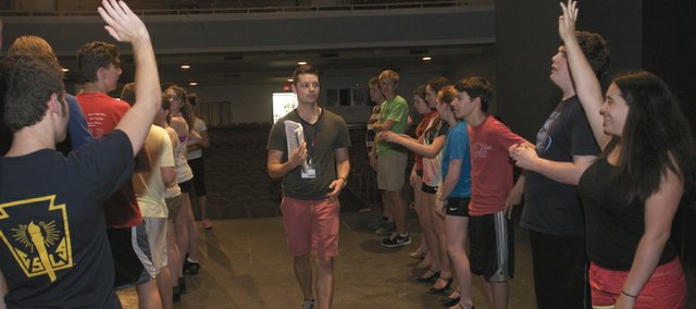 "Broadway at Baker choreographer Chris Allen gives instructions to two lines of dancers Monday on Baker University's Rice Auditorium stage at the musical theater camp. The students ages 13 through 18 arrived for the camp Sunday and will present a performance of ""My Favorite Year"" at 2:30 p.m. Sunday."