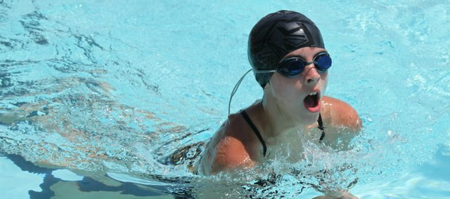 Marisa Kearns was one of 34 Tongie Tidal Waves to compete in four events at the East Kansas Swim League championships Thursday in Bonner Springs.