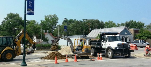 Tonganoxie  city crews work to determine the origin of a water leak Wednesday, July 10, 2013, in downtown Tonganoxie. The work was being done at Fourth and Delaware streets. Work continued Friday, July 12.