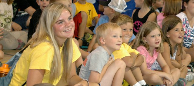 From left, camp counselor Bailey Hightower of Bonner Springs laughs Friday as she watches one of the camp's variety show skits along with campers Brayden Cannon of Edwardsville, Zaden Smith of Basehor, Kylie Rice of Piper and Jordan Powell of Bonner Springs.
