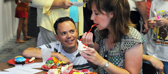 Kevin and Shawna Garber judge the cupcake contest at the July Art Walk last year. The cupcake contest will return Friday for the season's second Art Walk.