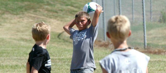 Wyatt Martin throws the ball in to an open teammate during a scrimmage at last week's Kids Kamp.