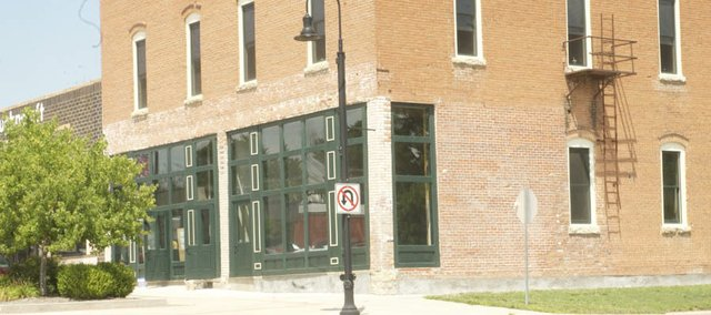 The renovated building at Sixth and High street will have its first tenant will the planned move of the East Kansas Cooperative in Education in October from its current home on Chapel Street. It is one of several recent moves or changes downtown.