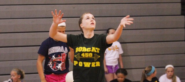 BLHS sophomore Courtney Robinson participates in a serving drill during the Bobcats' team camp last month. BLHS aims to return to the state tournament after qualifying in 2012.