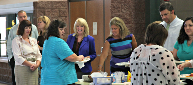 Members of Basehor PRIDE welcomed USD 458's new teachers with a lunch Monday at Basehor-Linwood High School. The Association of Basehor-Linwood Educators also welcomed its new teachers with a breakfast that morning.