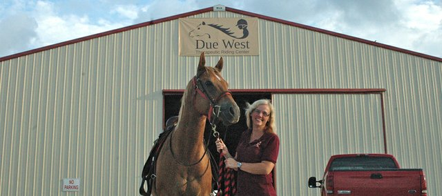 Mary Sharp stands with Chance, one of several therapy horses used at the Due West Therapeutic Riding Center, which earlier this year located in western Wyandotte County to offer therapeutic riding for children and adults with special needs.