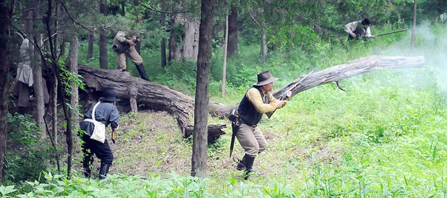 """Re-enactors stage the Battle of Black Jack at at 2011 event at the site east of Baldwin City. The National Geographic Channel program """"Diggers"""" will air the show """"Diggers: Bleeding Kansas"""" at 7:30 p.m. Wednesday, which includes a visit to the Black Jack site."""