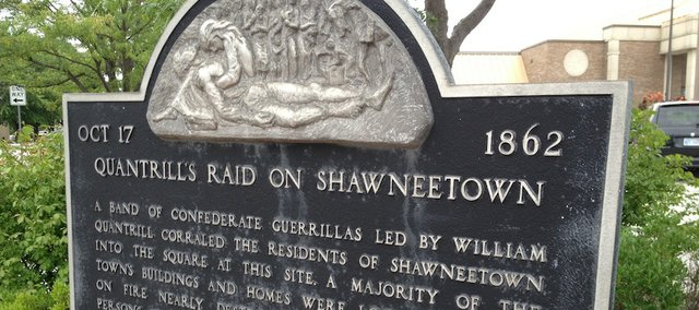 This historical marker outside City Hall commemorates Quantrill's 1862 raid on Shawnee.
