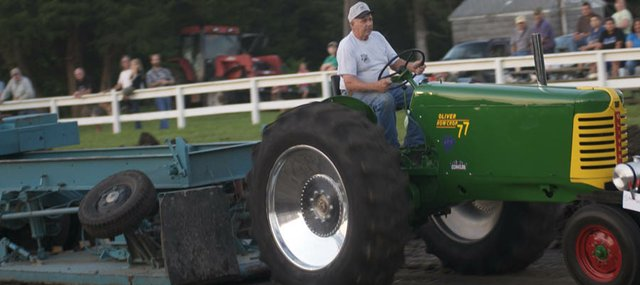 Jim Sack pulls the sled at the Vinland Fair tractor pull with his vintage Oliver 77 tractor. The Vinland farmer pulled the sled nearly to the end of the track.