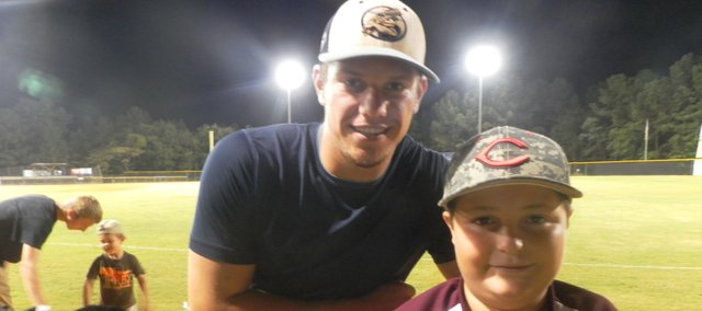SM Northwest alum Chase Rader, left, joins 11-year-old Clinton, N.C. native Dawson Batts after one of Rader's games playing for the Fayetteville SwampDogs this summer. Rader, who is about to begin his second season playing at Coffeyville Community College, struck up a friendship with Dawson, who has played baseball for years despite being born with just one arm.