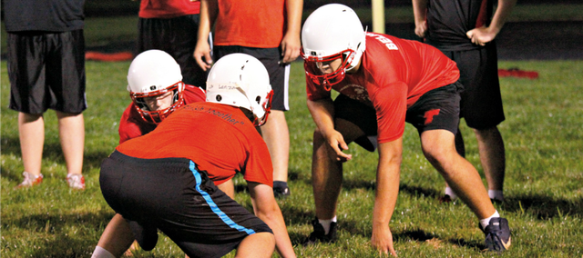 The Tonganoxie High football team officially opened its 2013 season with a 12:01 a.m. practice Monday at Beatty Field.
