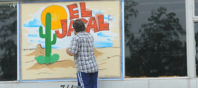Mike Langrehr puts the finishing touches on the sign for El Jacal. Owners of the new Mexican restaurant at 711 High Street say it should be open by Sept. 1.