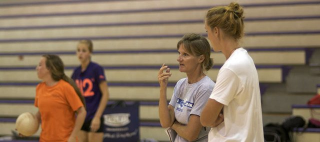 Baldwin High School volleyball coach talks with her daughter and assistant Emily Brown during the team's practice Thursday. Expectations are high for the team that won its summer league and returns a solid group of players.