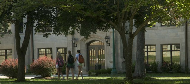 Baker University students walk Tuesday past Mulvane Hall. The building's renovation and addition of the Ivan Boyd Center are credited with helping boost the school's freshman enrollment to the highest number since 2009.