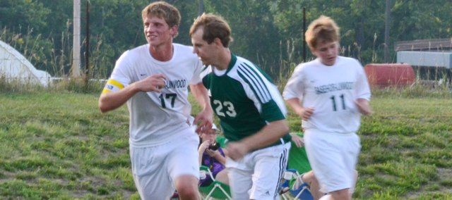 BLHS senior Sean Potter (17) and alum Matt Sixta (23) compete in the first ever BLHS boys soccer alumni game on Aug. 23.
