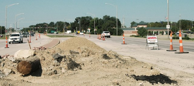 Construction near the intersection of Shawnee Mission Parkway and Pflumm Road is expected to last through October. A small white sign marks the entrance to the Savers Thrift Store on the south side of the roadway.