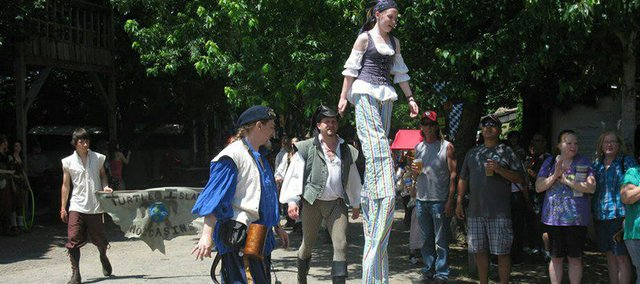 Claire Gurley walks on her stilts at the Castle of Muskogee, a Renaissance festival in Oklahoma.