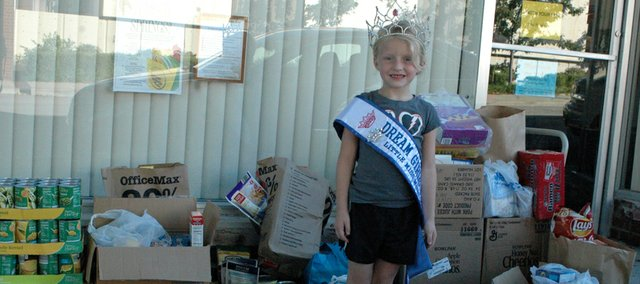 Inspired in part by the volunteer work she has done as a pageant contestant, Leanna Larson, 6, and her family quickly worked to gather 329 pounds of food in less than a week for the Vaughn-Trent Community Services food pantry.