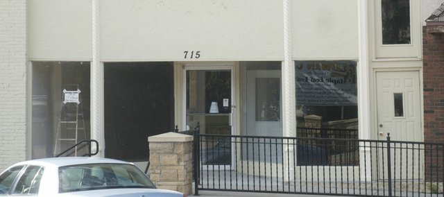 Alan and Amy Wright recently purchased the storefront at 915 High Street and are remodeling the ground floor into two offices. One will be the home of Amy Wright's property management business.
