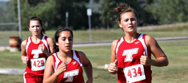 Taylar Morgan, right, led the Tonganoxie High junior varsity team Thursday at the Holton Invitational.