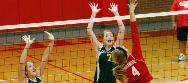 Sierra Smith, left, and Jordan Eriksen helped the Basehor-Linwood volleyball team defeat Tonganoxie in straight sets on Tuesday.