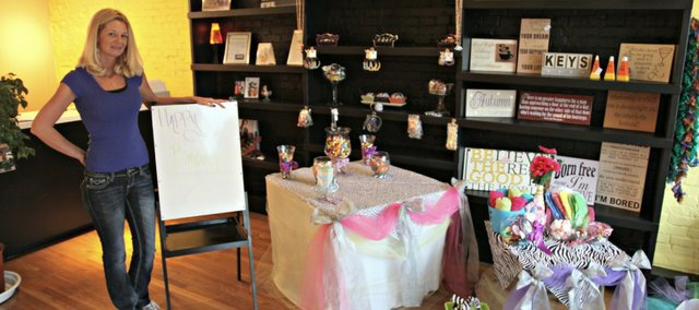Shelbie Jaster is the owner of Creative Nail in downtown Tonganoxie. The business offers manicures, pedicures and other nail services. Jaster also sells home decor from The Ruffled Daisy, displayed along the wall. She also offers gift packages for girls' birthdays.