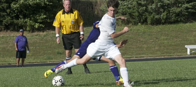 Baldwin senior Duncan Murray looks to advance the ball in Thursday's match between the Bulldogs and visiting Louisburg. Murray scored a goal in Baldwin's 5-1 victory in the storm-shortened match.