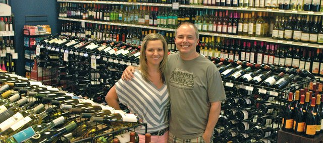 Jeff Jones (right) and Micki Drozinski, who opened Grand Slam Liquor, 608 Tulip Drive, Suite A, earlier this year, say they offer a larger selection of specialty wines and craft beers than most area liquor stores.