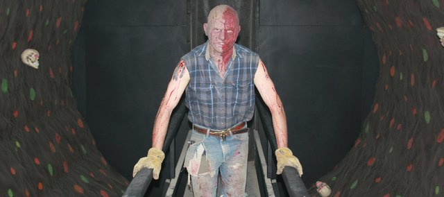 "Bryce Peterson, 22, has spent the last three years better known as ""Backwoods Butch"" at the 3rd Street Asylum Haunted House in Bonner Springs' 1918 Building."