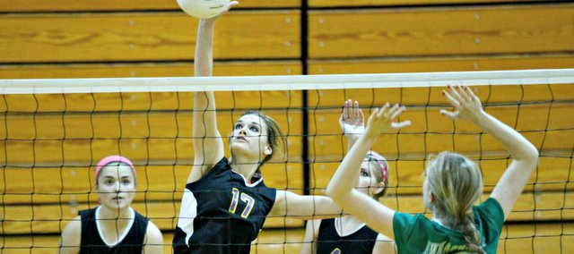 Rebecca Boyd goes up for a kill in Tuesday's triangular at McLouth High. The Bulldogs went 1-1, falling to Immaculata and defeating Oskaloosa.