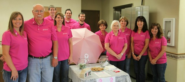 Employees at Community National Bank's Tonganoxie branch are wearing pink on Fridays this month to support Breast Cancer Awareness Month and raise money for a local organization. Pictured, from left, are Shannon Sneed, Art Hancock, Danny Mason, Heather Tegtmeier, Jamie Smith, Joseph Bronson, Marie DeMaranville, Rita Bailey, Miss Saathoff, Diane Jennings and Scherie Bohannon.