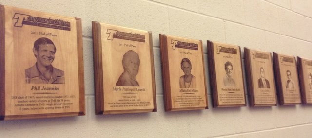 Plaques honoring past Tonganoxie USD 464 Education Foundation inductees grace the north wall of the lobby area near the Tonganoxie Performing Arts Center on the Tonganoxie High School campus. A handful of plaques will be added soon as this year's class will be inducted during Friday's homecoming football game against Turner.