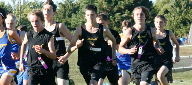 Ryan Bristol, center, led the McLouth High boys with a 17th-place finish at the McLouth Invitational.