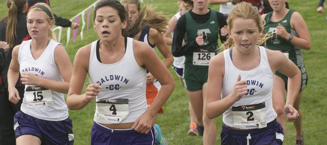 Libby Verheaghe, (left), Hannah Hutton and Addie Dick run together in the girls race Saturday at the Baldwin Golf Course