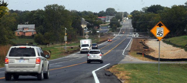 Traffic flows on U.S. Highway 56 in west Baldwin City for the first time since late April with the end of construction on the highway. Hamm Construction took down barricades Friday after with the end of projects to replace three bridges on the highway and upgrade the Lawrence Street intersection.