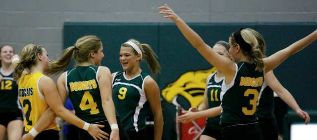 Basehor-Linwood players celebrate a point in Tuesday's Kaw Valley League match against Piper. The Bobcats defeated the Pirates in five sets.