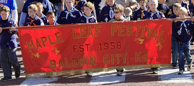 Baldwin City Cub Scouts march in last year's Maple Leaf Festival Parade. Entrees will start at 11 a.m. Saturday.