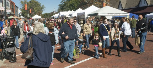 Festival-goers fill Eighth Street at about 1 p.m. Saturday at the Maple Leaf Festival.